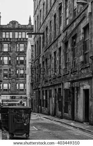 GLASGOW SCOTLAND APRIL 2, 2016: A typical backstreet alleyway in the Scottish city of Glasgow on 2nd April 2016. - stock photo
