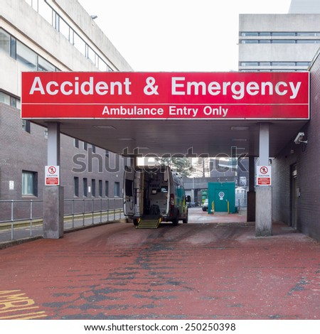GLASGOW, SCOTLAND - 3 FEBRUARY 2015: Glasgow General Royal Infirmary A&E entrance with open ambulance parked outside - stock photo