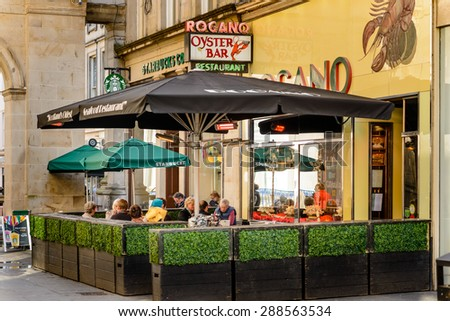 GLASGOW, SCOTLAND - JUNE 03, 2015 : The Rogano is the oldest surviving restaurant in Glasgow  serving the finest fish and seafood in the world from Scottish waters. - stock photo