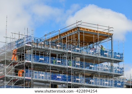 GLASGOW, SCOTLAND - MAY 16, 2016: Plettrac Metrix scaffold system being used at a residential property development site in Glasgow, Scotland.