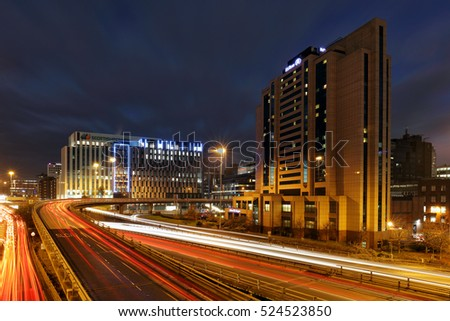 GLASGOW, SCOTLAND - NOVEMBER 26: car night trails heading to and from Glasgow city centre with the Hilton hotel and Scottish power buildings in view on November 26, 2016 in Glasgow, Scotland.