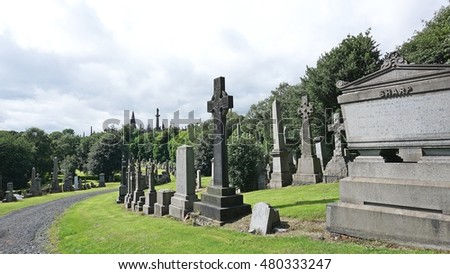 GLASGOW, SCOTLAND, UK - JULY 18, 2016 : The Glasgow Necropolis , Victorian cemetery in Glasgow, Scotland in July 18,2016. Fifty thousand individuals have been buried here.