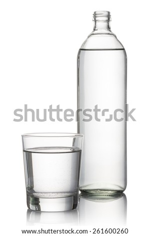 glass and bottle full of natural water, on white background - stock photo