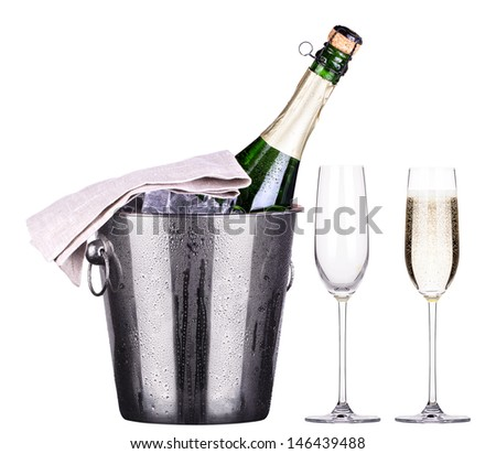 glass and bottle of champagne in Metal ice bucket  isolated on a white background