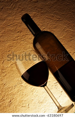 Glass and bottle of red wine close-up - stock photo