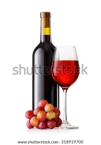 Glass and bottle of red wine with grapes isolated on white background