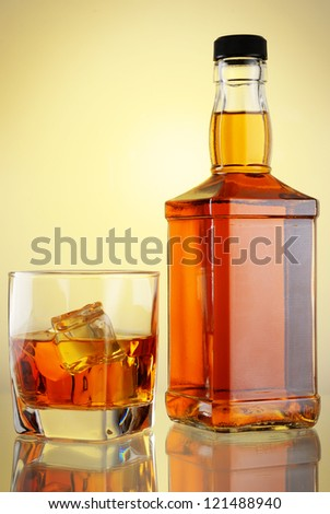 glass and bottle of whiskey - stock photo