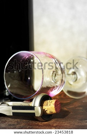 Glass and corkscrew. - stock photo