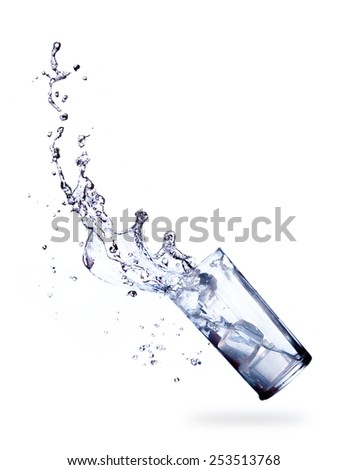 glass and Cubes ice of splashing drinking water on white - stock photo