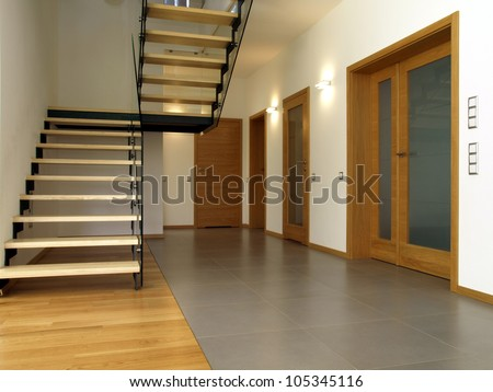 Glass and wooden stairs in the modern house interior