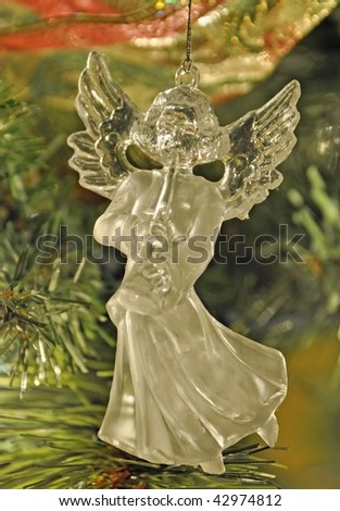 glass angel ornament playing instrument