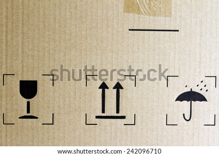 Glass, arrows and umbrella signs on cardboard - stock photo