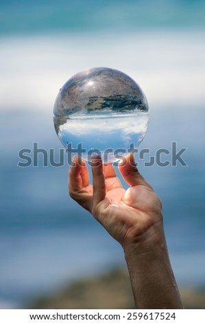 Glass ball in hand. - stock photo