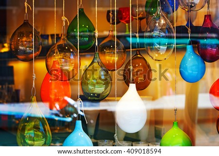 Glass balls marbles abstract colored mix in the shop window - stock photo