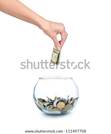 Glass bank for tips with money and hand isolated on white. Ukrainian coins - stock photo