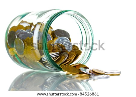 Glass bank for tips with money isolated on white. Ukrainian coins - stock photo
