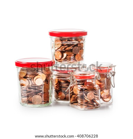 Glass bank jars with coins isolated on white background. Saving money concept. Group of objects with clipping path - stock photo
