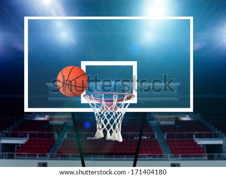 Glass basketball board and hoop with a missed shot - stock photo