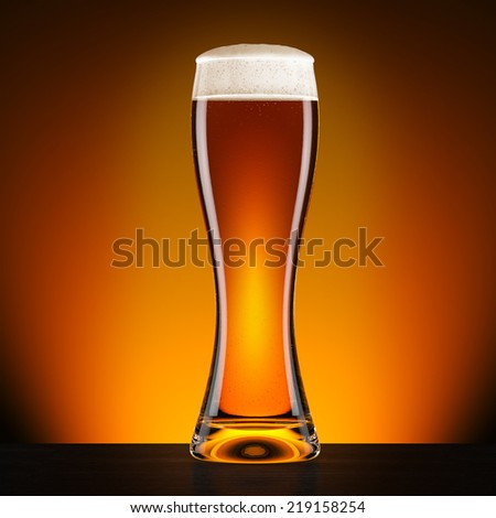 Glass beer on dark wood table with bright background. 3d illustration - stock photo