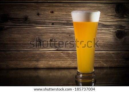 glass beer on wood background  - stock photo