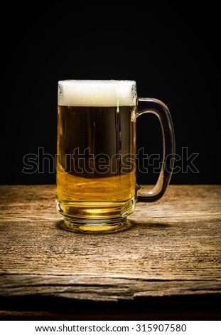 Glass beer on wooden background