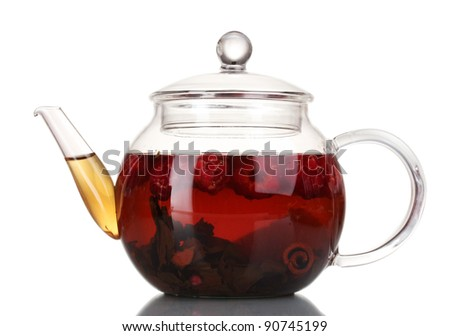 Glass black fruit tea in glass teapot isolated on white