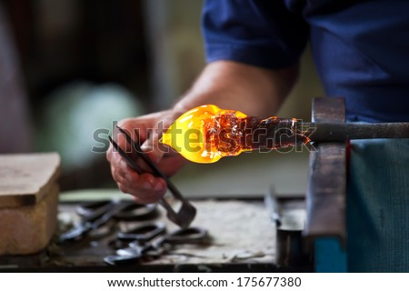 Glass blower forming beautiful piece of glass, Murano, Venice, Italy - stock photo