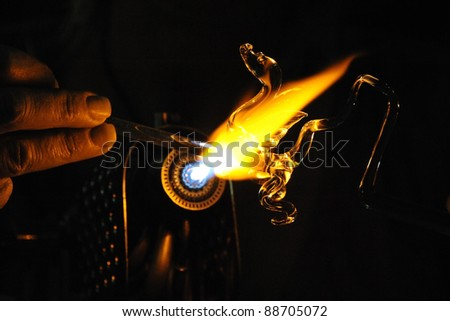 Glass-Blowing a Dragon - stock photo