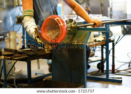 Glass blowing - shaping a vase - stock photo