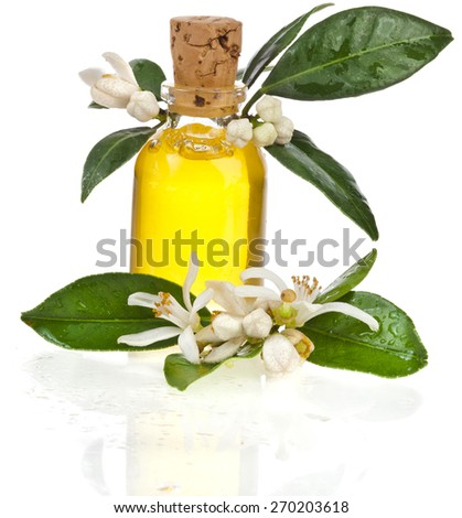 Glass bottle essential oil with fresh orange flower isolated on white background - stock photo
