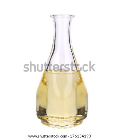 Glass bottle full with oil. Isolated on a white background.