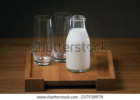 Glass bottle of ayran (turkish yogurt drink) on the wooden table