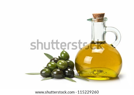 Glass bottle of premium virgin olive oil and some olives with leaves isolated on a white background - stock photo