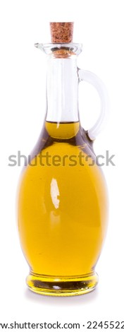 Glass bottle of premium virgin olive oil isolated on white background cutout - stock photo