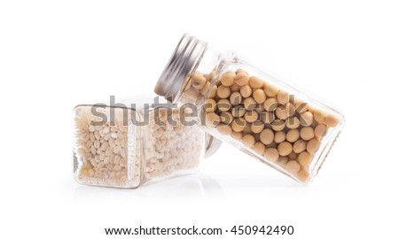 glass bottle of soybeans and Barley rice isolated on white background - stock photo