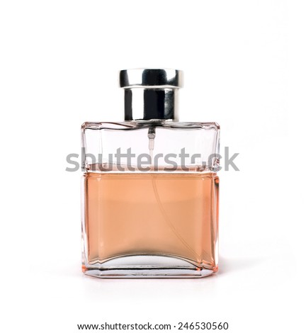 glass bottle of toilet water isolated on a white background with a beige-colored liquid - stock photo