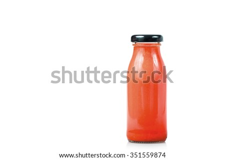Glass bottle of tomato juice isolated on white - stock photo