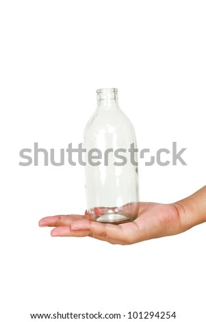 Glass bottle on hand. - stock photo