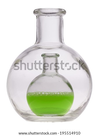 Glass bottle with a colored liquid against white background.
