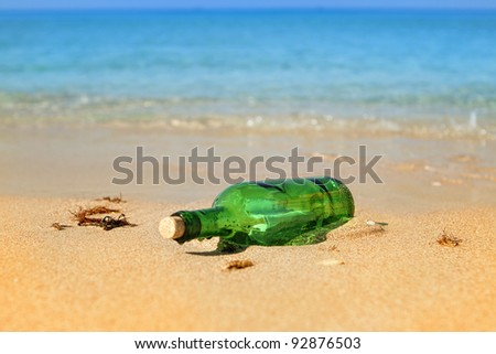 glass bottle with a letter - stock photo