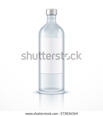 Glass bottle with blank label - stock photo