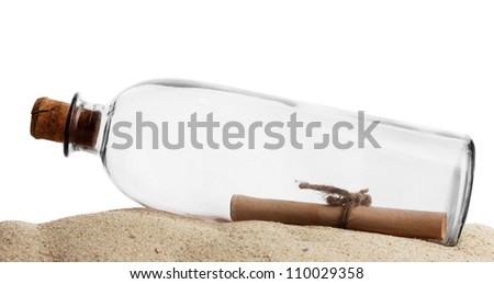 Glass bottle with note inside on sand isolated on white - stock photo