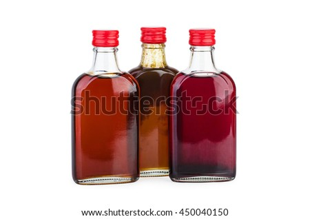 Glass bottle with pomegranate, sea-buckthorn and billberries sirup isolated on white background - stock photo