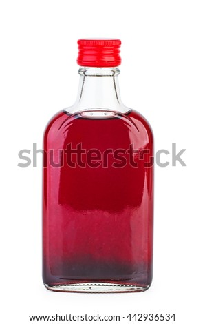 Glass bottle with pomegranate sirup isolated on white background - stock photo