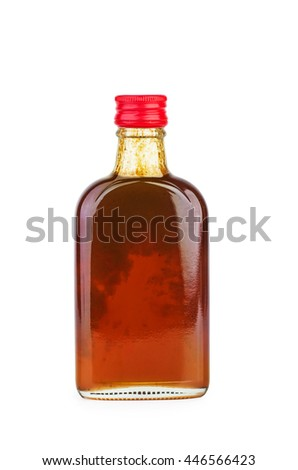 Glass bottle with sea-buckthorn sirup isolated on white background