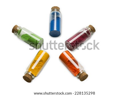 Glass bottles filed with colored powder