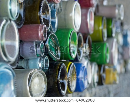 Glass bottles in a wall - stock photo
