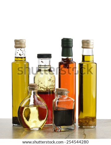 Glass Bottles Of Olive Oil,Salad Dressing And Vinegar - stock photo