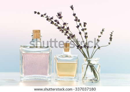 Glass bottles with cosmetic  on evening sea view  - stock photo