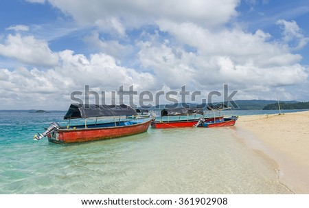 glass bottom boats parked at Jolly buoy Island in Andaman and Nicobar Island - stock photo